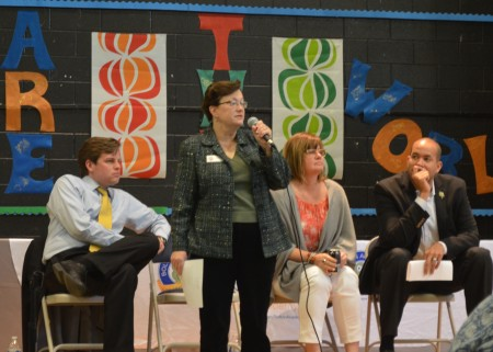 Atlanta school board member Cynthia Briscoe Brown talks to members of the North Atlanta Parents for Public Schools on March 23 as fellow board members, seated left to right, Matt Westmoreland, Nancy Meister and Jason Esteves listen from the stage at Bolton Academy.