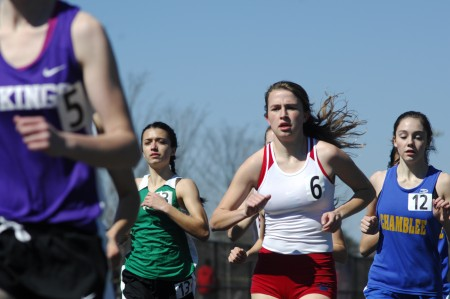 Dunwoody High School sophomore Samantha Cameron, center, runs during the second heat of the girl's 1-mile race.