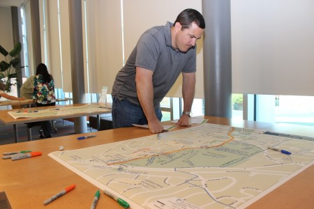 Chris Sheehan looks over a map of Ashford-Dunwoody Road during a recent open house for Brookhaven residents to make suggestions for what they would like to see. (Photo Dyana Bagby)