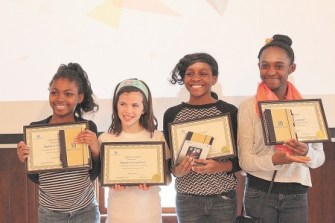 From left, Salena Selon, Kelly Quinn, Shayla Selon and Sydney Smith, participants in the Dunwoody-based Band of Coders/Girls Academy program. (Photo Dyana Bagby)