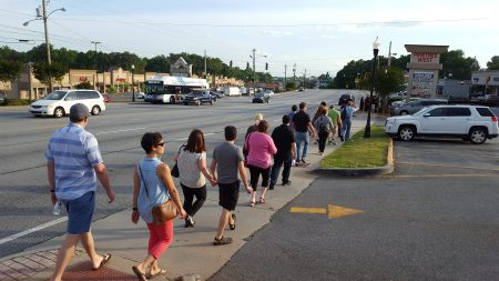 """""""Bus crawl"""" attendees walk on Buford Highway in Doraville on April 27. (Photo John Ruch)"""