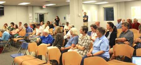 Nearly 100 people attended a public meeting at Brookhaven City Hall to learn more about a proposed townhome development on Ashford-Dunwoody Road. (Photo Dyana Bagby)