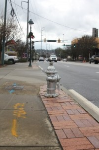 A fire hydrant at 6075 Roswell Road in Sandy Springs was missing for four months before Atlanta's Department of Watershed Management replaced it in December 2015 with the new hydrant pictured above shortly after installation. (Photo John Ruch)