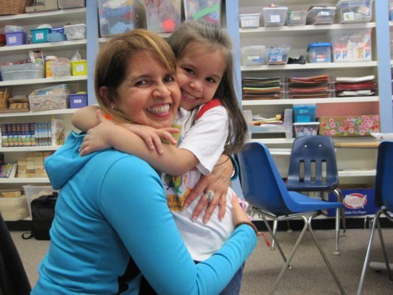 Sophia Monje, 4, gives a goodbye hug to Maritza Morelli, executive director of Los Ninos Primero, as she leaves the program's Saturday School.