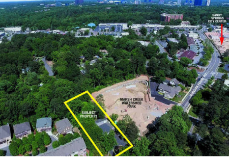 A National Auction Group aerial photo showing the location of the 80 Johnson Ferry Road property next to the Marsh Creek pond project.