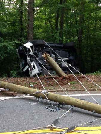 A vehicle crashed into a power pole Saturday morning, causing a power outage. (Via Sandy Springs Police)