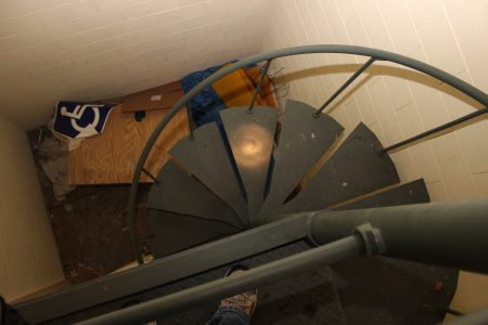 Spiral staircase leading to projection booth/lighting booth.
