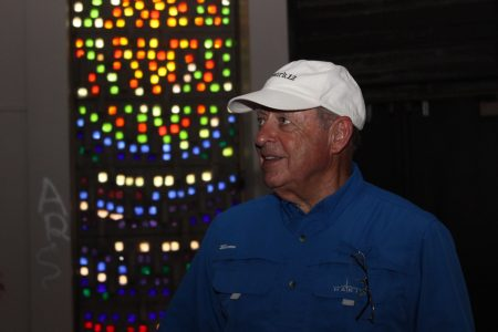 Danny Ross stands in front of historic stained glass in the chapel of the former Georgia Retardation Center. Ross envisions it as a place to hold weddings or catered events with the renovation of the building in Brook Run Park. (Photo Dyana Bagby)