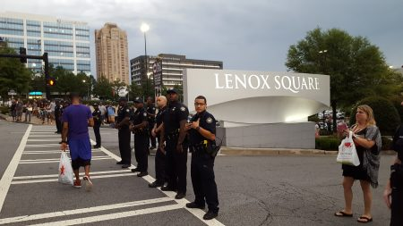 Police guard the mall. (Photo John Ruch)