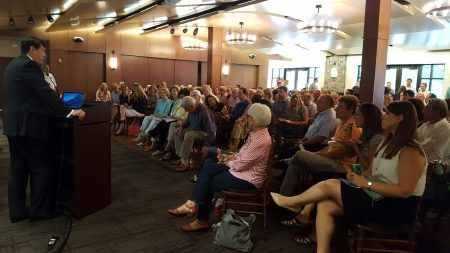 Sandy Springs Mayor Rusty Paul welcomes a crowd of 150 residents to the Next Ten planning presentation July 20 at Heritage Hall. (Photo John Ruch)