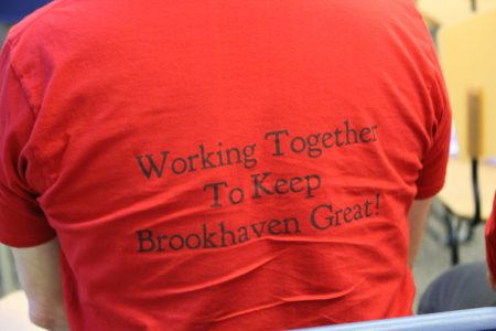 Dozens of homeowners opposed to the Solis Dresden development attended the July 26 City Council meeting wearing red shirts, several with these logos. (Photo Dyana Bagby)