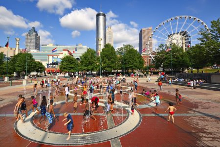 ATLANTA - AUGUST 25: Children play at Centennial Olympic Park August 25, 2013 in Atlanta, GA. The park commemorates the 1996 Atlanta Olympics.