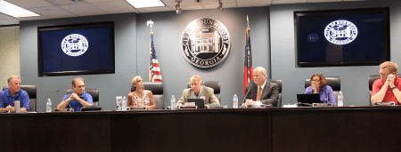 Dunwoody City Council voted 5-2 on July 10 to settle lawsuits with Center for Discovery over Manget Way home treatment facility. Voting no were Councilmembers Terry Nall and John Heneghan.