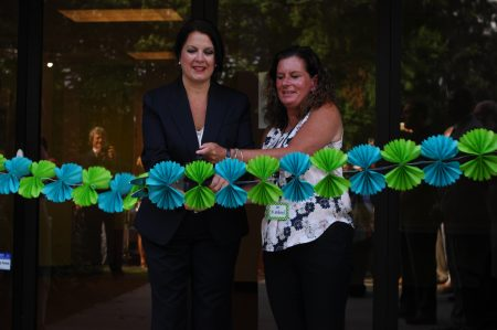 Jennifer Langley, BIA chair of the board, left, and Dr. Laurie Kimbrel, BIA head of school, cut the ribbon on the first day, Aug. 2. (Photo Phil Mosier)