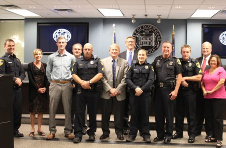 Dunwoody City Council members congratulate police officers for using the drug naloxone to save the lives of recent overdose victims. (Photo Dyana Bagby)
