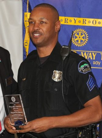 """Former Sandy Springs Police Officer Ron Momon, pictured receiving the departments """"Supervisor of the Year"""" award in 2013. (File Photo)"""