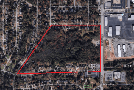 A Google Earth map showing the former DeKalb-Peachtree Airport land in red.