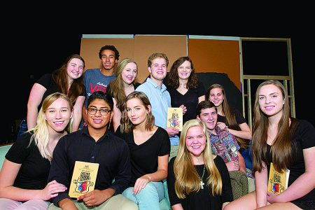 """Riverwood International Charter School Theater members pose with the """"Lend Me a Tenor"""" script. (James Barker Photography)"""