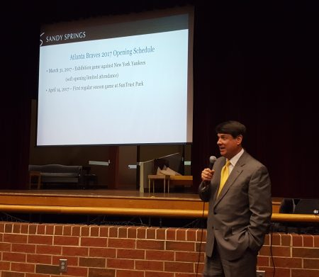 Sandy Springs Mayor Rusty Paul notes that Opening Day is fast approaching at the Braves stadium traffic forum at Riverwood International Charter School Sept. 21. (Photo John Ruch)