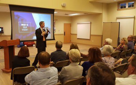 Eric Bosman of Kimley-Horn explains the Buckhead master plan process to the crowd Oct. 17 at Atlanta International School. (Photo John Ruch)
