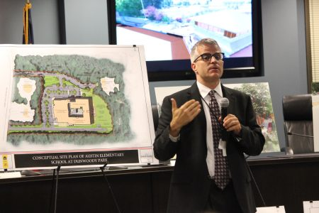 DeKalb schools Planning Director Dan Drake discusses the construction of a new Austin Elementary School where the Dunwoody Senior Baseball fields are currently located. (Photo Dyana Bagby)