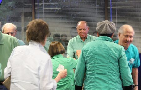 Danny Ross, center, accepts checks from attendees at the Oct. 24 Dunwoody City Council meeting who want to save the theater at Brook Run Park. (Photo Dyana Bagby)