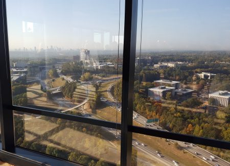 """The view of the I-285/Ga. 400 interchange from the 32nd floor of the Concourse Center's """"King Building."""" (Photo John Ruch)"""