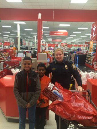 """A Brookhaven police office with children during the 2015 """"Shop with a Badge"""" event. (BPD)"""