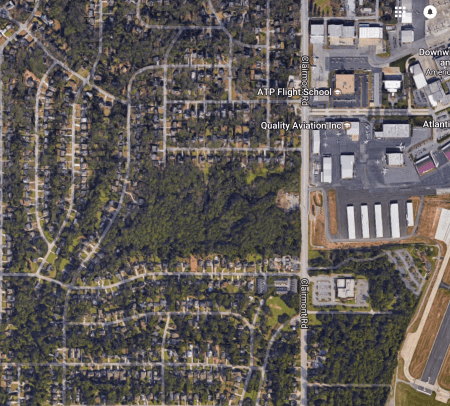 The Brookhaven City Council approved a contract to buy the PDK Airport wooded property in the center of this Google Earth image.
