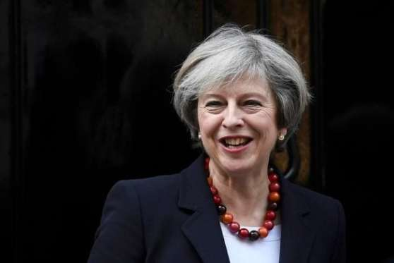 FILE PHOTO: British Prime Minister Theresa May smiles as she greets her French counterpart Bernard Cazeneuve at Number 10 Downing Street in London, Britain, February 17, 2017. REUTERS/Toby Melville/File Photo