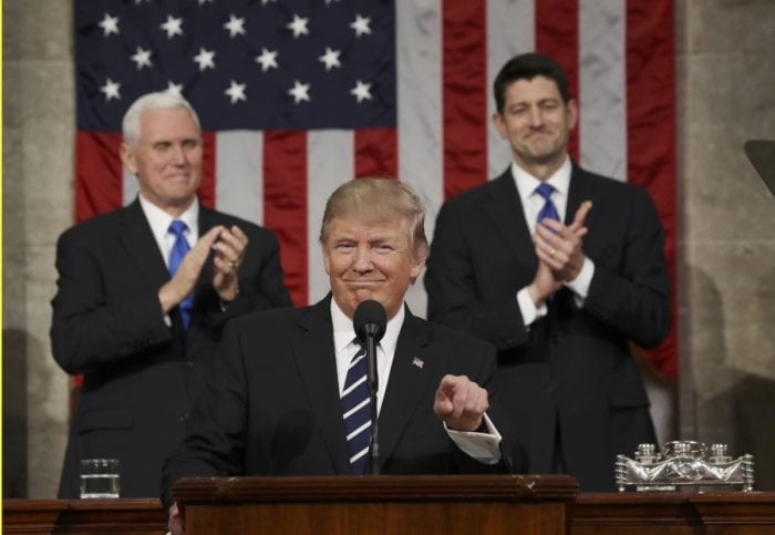 US Vice President Mike Pence (L) and Speaker of the House Paul Ryan (R) applaud as US President Donald J. Trump (C)REUTERS/Jim Lo Scalzo