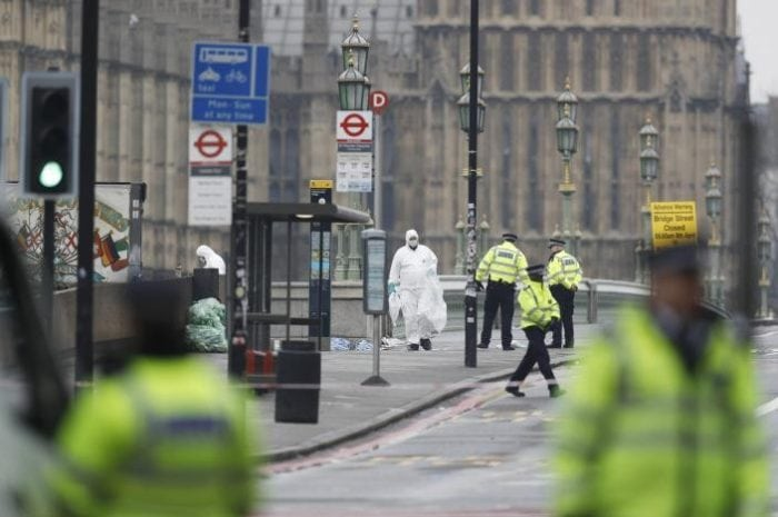 Police officers and forensics investigators and police officers work on Westminster Bridge the morning after an attack by a man driving a car and weilding a knife left five people dead and dozens injured, in London, Britain, March 23, 2017. REUTERS/Darren Staples