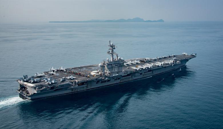 The U.S. aircraft carrier USS Carl Vinson transits the Sunda Strait, Indonesia on April 15, 2017. Picture taken on April 15, 2017.    Sean M. Castellano/Courtesy U.S. Navy/Handout via REUTERS