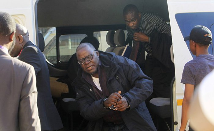 Tendai Biti arrives at the magistrates courts in Harare, Thursday Aug. 9, 2018. Biti was deported to Zimbabwe following his arrest in Zambia after his asylum bid was rejected. Biti's plight has raised concerns about a wave of repression against the opposition by the government of Zimbabwe's President Emmerson Mnangagwa. (AP Photo/Tsvangirayi Mukwazhi)
