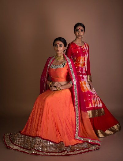orange-silk-lehnga-choli-with-the-mirror-work-over-d-neck-line-n-heavy-border-with-the-touch-of-valvet-and-the-chiffon-dupatta-with-mirror-border-and-georgette-skirt
