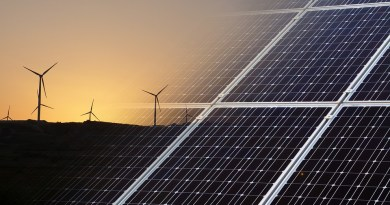 photo of wind turbines and solar panels
