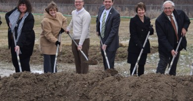 From left; Portage County Commissioners Sabrina Christian-Bennet and Vicki Kline, Treasurer Brad Cromes, Commissioner Mike Kerrigan, PARTA general manager Claudia Amrhein and Kent Mayor Jerry Fiala