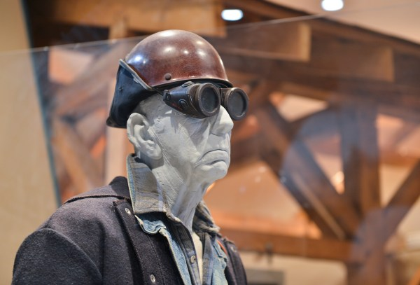 A mannequin dressed as a steel worker