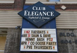 The closed night club sign still advertises $2 Tuesdays.