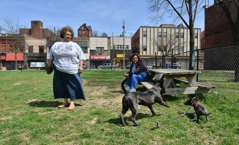 Sharon Newsom and Nelwyn Carley watch their dogs play in the dog park