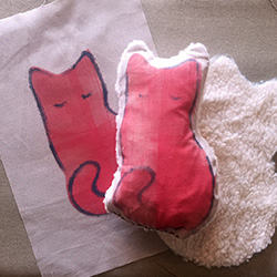 Handmade toy cat using upcycled reprinted fabric from reprint and repurpose.