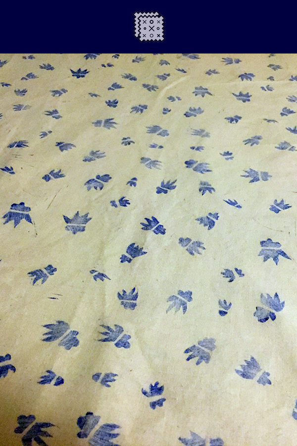 Blue abstract, almost floral print on white cotton fabric from Reprint and Repurpose.