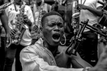a young man sits during an EndSARS protest in Lagos