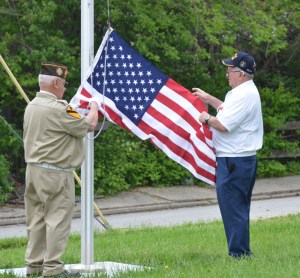 Grundy County Museum Board member Bob Chenoweth and VFW Commander Lannie Harkins raised the flag during Monday's Memorial Day ceremony at the Grundy County Museum/Baker School.
