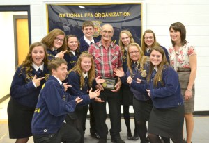 Photo Courtesy of Grundy R-5 High School Long-time Grundy R-5 bus driver and school supporter Darrel Cunningham received the Blue and Gold Award from the Grundy R-5 FFA during Thursday night's annual banquet. Pictured with Cunningham are the new chapter officers along with advisor Rebecca Steinhoff.