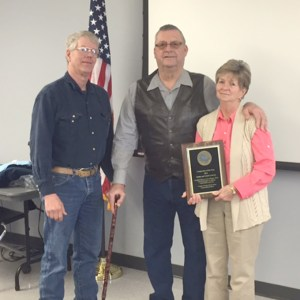 "Galen and Linda Lowrey received the ""Cooperator of the Year"" award from the Grundy County Soil and Water Conservation District during its annual customer appreciation event on Friday. The Lowreys, at right, are pictured with Kendall Foster, president of the SWCD Board."
