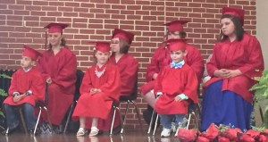 Photo Courtesy of Spickard R-2 School Graduation ceremonies were held on Tuesday night at the Spickard R-2 School for members of the kindergarten and sixth grade classes. Kindergarten graduates included, from left, front row, Edward Crawford, Alaina Roberts and Randall Wilson. Sixth grade graduates, pictured from left on the back row, were Kyla Coffman, Arrian Lawrence, Nicholas Roberts and Breann St. Onge.