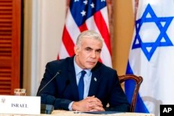 Israeli Foreign Minister Yair Lapid attends a news conference at the State Department in Washington, Oct. 13, 2021.