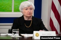 FILE - Treasury Secretary Janet Yellen listens during a meeting in the South Court Auditorium on the White House campus, Oct. 6, 2021, in Washington.