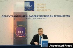 Italian Prime Minister Mario Draghi is seen during a press conference at the end of a G-20 virtual summit on Afghanistan, in Rome, Italy, Oct. 12, 2021.